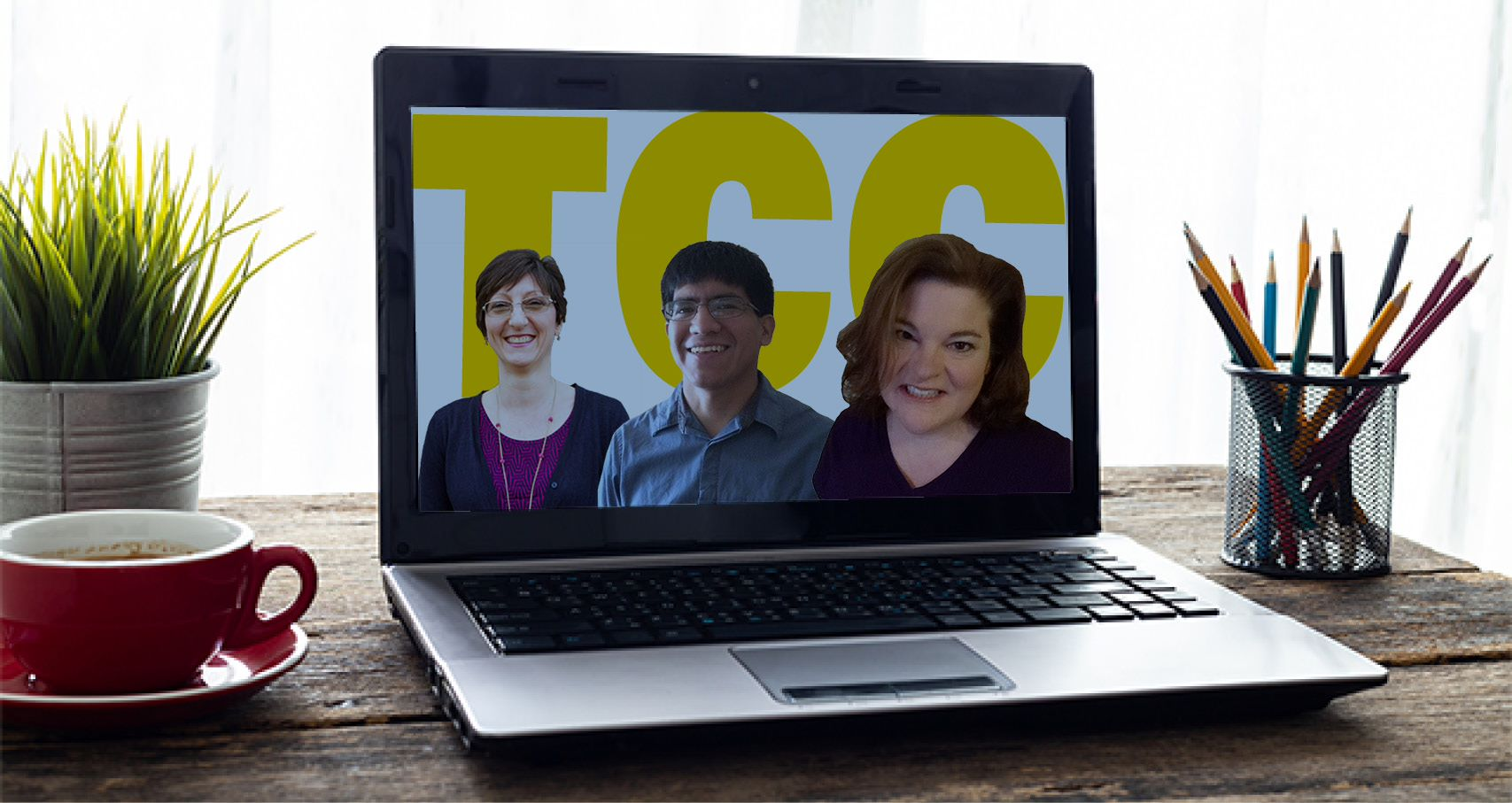 open laptop with a photo of 3 smiling people onscreen